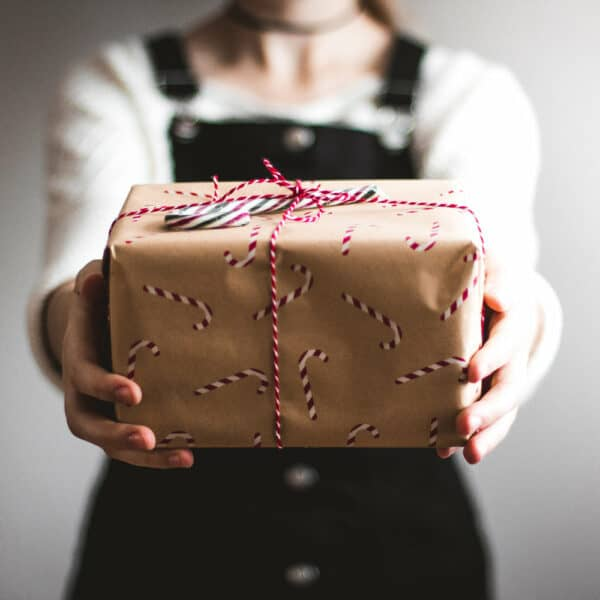 Someone handing over a gift