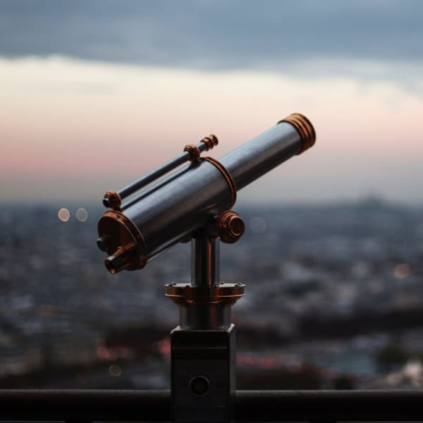 A telescope on top of a tall building