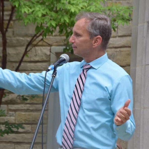 Pastor Rich speaking outside of church doors