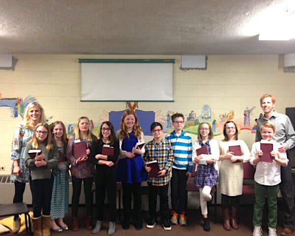 Sunday School kids holding bibles