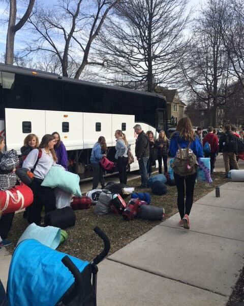 Youth program kids about to get on a camping bus
