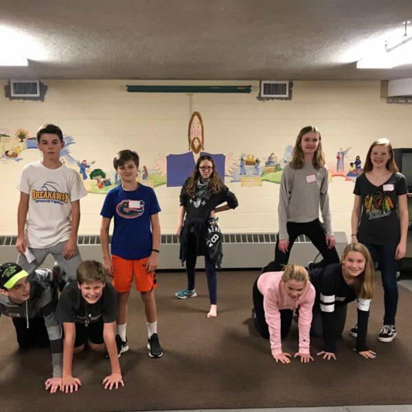Youth program kids doing gymnastics together